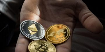 Crypto currency being held in a hand